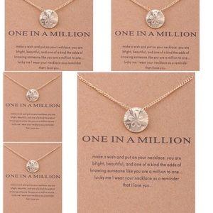 Bundle of 5 sand dollar necklaces